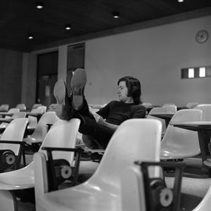 Primary view of object titled '[Student in an empty classroom]'.