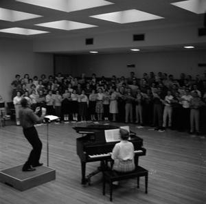 Primary view of object titled '[A Cappella Choir rehearsing with Director Frank McKinnely]'.