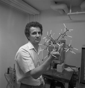 Primary view of object titled '[Chemistry student holding a 3D model]'.