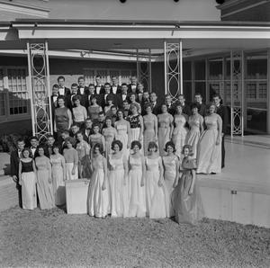 Primary view of object titled '[Choir members standing in front of a building]'.