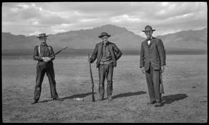 Primary view of [Three hunters with a dead squirrel]