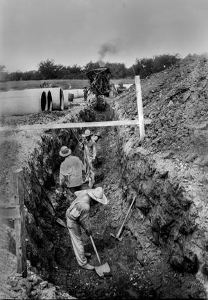 Primary view of object titled '[Men working in a ditch on Berry Street]'.