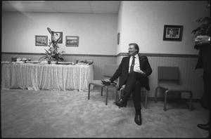 Primary view of object titled '[Televangelist on a chair]'.
