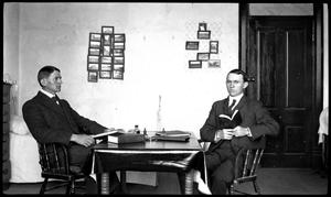 Primary view of object titled '[Byrd Williams Jr. and brother Johnson, sitting in their dorm at U.T.]'.