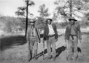 Primary view of object titled '[Three men with rifles]'.
