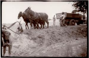 Primary view of object titled 'Laying bricks on Berry Street'.