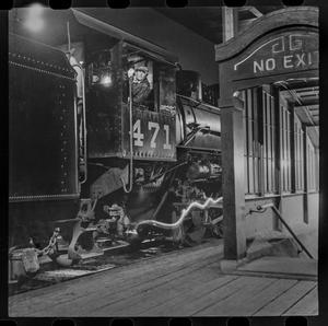 Primary view of object titled '[T&P conductor at the station at night]'.