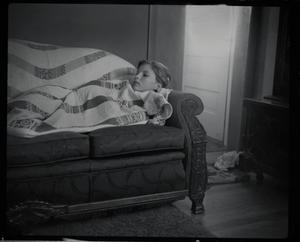 Primary view of object titled '[Carol Williams lying on a couch]'.