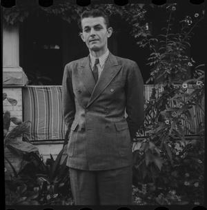 Primary view of object titled '[Man in a double-breasted suit]'.