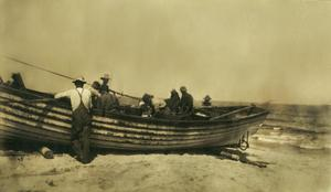 Primary view of object titled '[Men preparing a boat for travel]'.