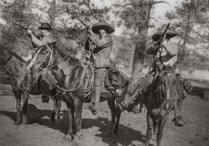 Primary view of object titled '[Three men on horses with guns]'.