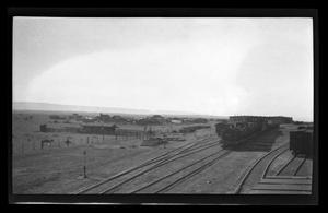 Primary view of object titled '[Photo of a train docked at a railroad station]'.