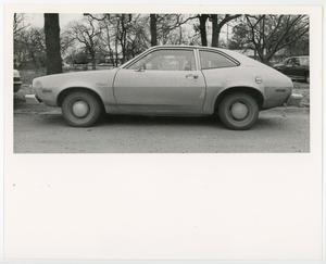 Primary view of [A 1970s Ford Pinto parked near trees]