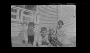 Primary view of object titled '[Irene and her kids in the front yard]'.