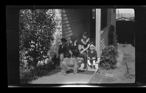 Primary view of object titled '[John, Byrd III, Irene, and Charles Williams sitting on a porch]'.