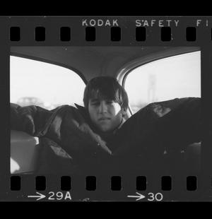 Primary view of object titled '[Byrd Williams, IV in the backseat of a car]'.