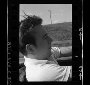 Primary view of object titled '[Photo of a boy sitting in the driver's seat of a 1956 Ford]'.