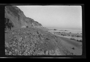 Primary view of object titled '[Photo of Model T's driving along a shoreline]'.
