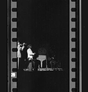 Primary view of object titled '[Two men playing at a Jimmie Lunceford show]'.