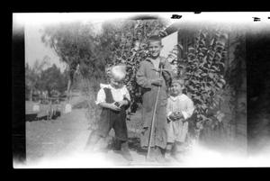 Primary view of object titled '[Unknown boy with John and Charles Williams]'.
