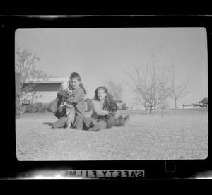 Primary view of object titled '[Two kids with dogs]'.