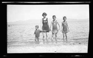 Primary view of object titled '[Irene Williams and her sons standing in water on a shoreline]'.