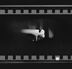 Primary view of object titled '[A man plays piano at a Jimmie Lunceford show]'.