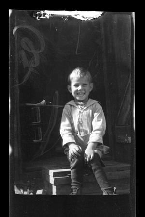 Primary view of object titled '[Photo of Charles Williams sitting on a porch]'.