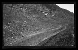 Primary view of object titled '[A dirt road on the side of a hill]'.