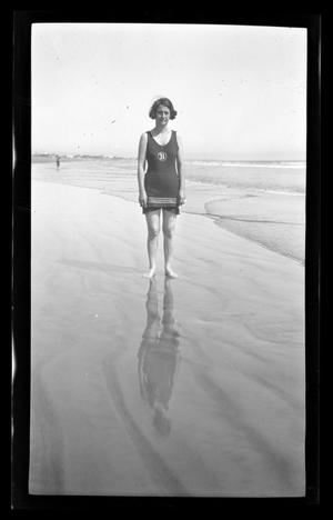 Primary view of object titled '[Irene Biffle Williams standing on a beach]'.