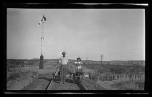 Primary view of object titled '[Photo of two men on a rail cart]'.