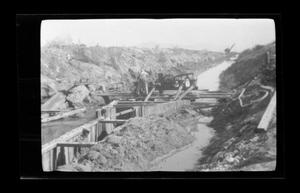 Primary view of object titled '[Men working alongside a creek]'.
