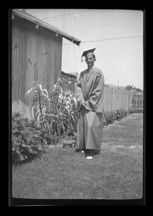 Primary view of object titled '[John Williams wearing a cap and gown]'.