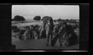 Primary view of object titled '[Byrd Williams Jr. on a beach]'.