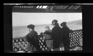 Primary view of object titled '[John, Charles, Irene, and Byrd Williams III standing on a deck]'.