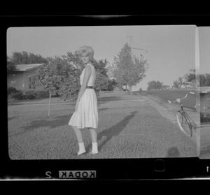 Primary view of object titled '[Carol Williams standing in a yard]'.