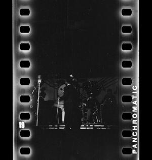 Primary view of object titled '[Jimmie Lunceford conducting his band]'.