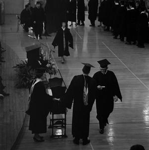 Primary view of object titled '[Graduating Student Receiving Diploma at Commencement]'.