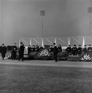 Primary view of object titled '[Graduating Students Walk to Receive Diplomas]'.