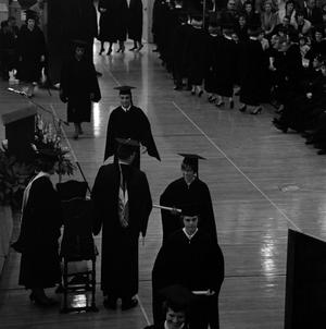 Primary view of object titled '[Graduating Students Receiving Diplomas at Commencement]'.