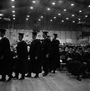 Primary view of object titled '[Young Men in Line to Receive Diplomas]'.
