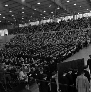 Primary view of object titled '[Students in Line to Receive Diplomas at Commencement Ceremony]'.