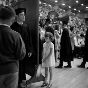 Primary view of object titled '[A Little Girl at Commencement Ceremony]'.