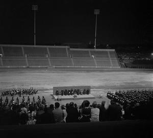 Primary view of object titled '[Commencement Ceremony on Fouts Field at Night]'.
