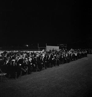 Primary view of object titled '[Faculty Staff Seated at Commencement Ceremony on Fouts Field, 2]'.