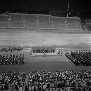 Primary view of object titled '[Commencement Ceremony in Fouts Field Stadium]'.