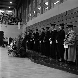 Primary view of object titled '[Faculty Staff Present at Commencement Ceremony]'.