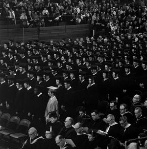 Primary view of object titled '[Graduating Students Standing at their Commencement Ceremony]'.