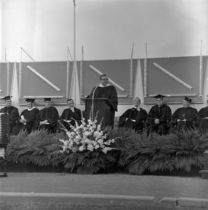 Primary view of object titled '[Speaker at Commencement Ceremony on Fouts Field]'.