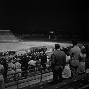 Primary view of object titled '[Family Members in Bleachers at Commencement Ceremony, 2]'.